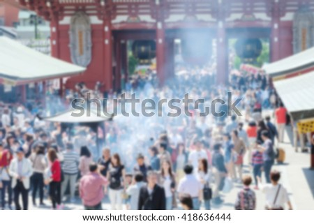 Motion blur of crowd in the temple with incense smoke in japan - stock photo
