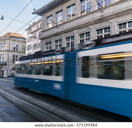 Motion blur of electric tram in the city of Zurich, Switzerland - stock photo