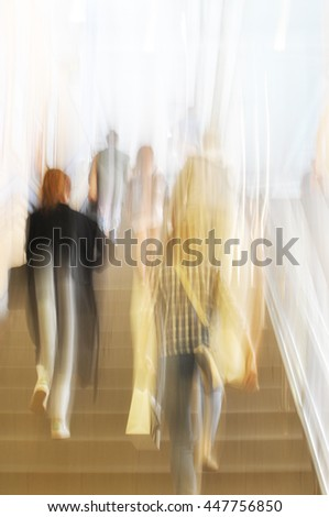 Motion blur of people going up stairs at rush hour. - stock photo