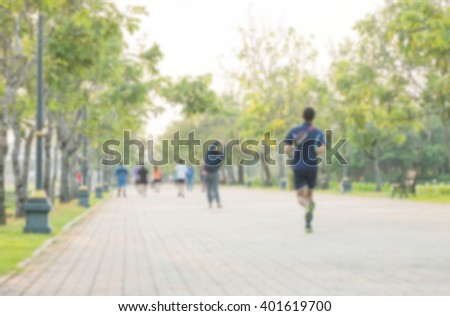 Motion blur of people running for exercise in the park