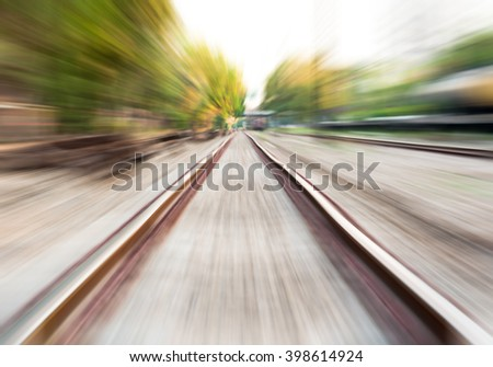 motion blur of railway moving forward by train - stock photo