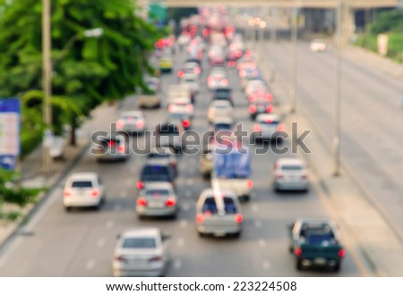 Motion blur of traffic jam on road in city.