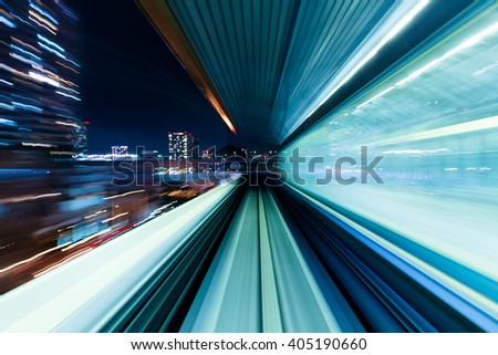 Motion blur of train moving inside tunnel - stock photo