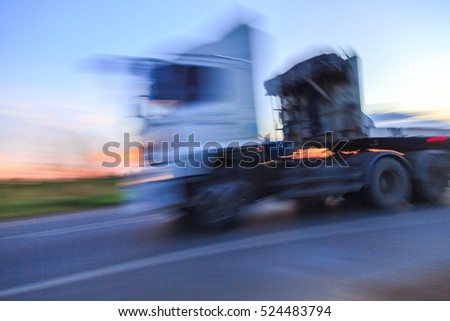 Motion Blur of Truck on Highway at twilight