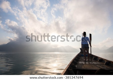 Motion blur of woman on boat
