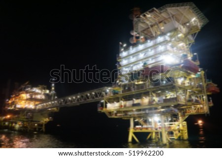 Motion blur offshore oil and gas rig platform in the middle of South China Sea at night scene.Construction of production process in the sea. Power energy of the world.