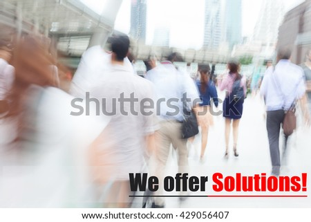 motion blur people walking to work, we offer solutions, business management concept