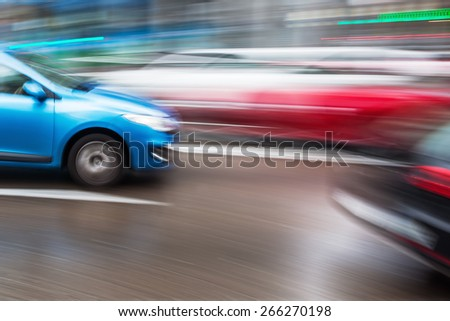 motion blur picture of traffic on a wet city street - stock photo