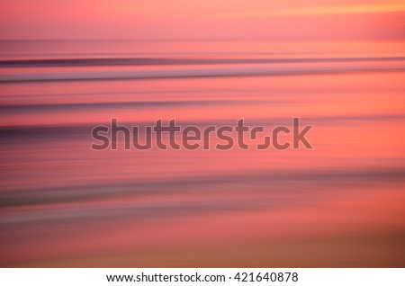 Motion blur tropical sunset beach and smooth wave. Travel concept. Retro color style. - stock photo