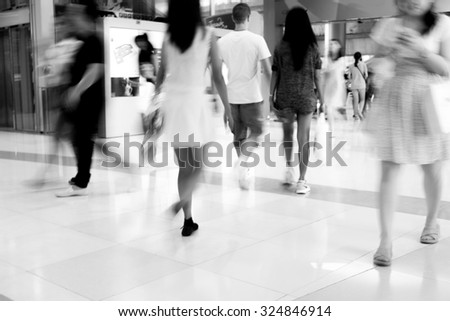 Motion blur walking people in black and white - stock photo