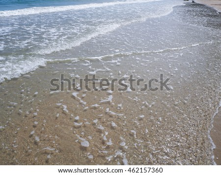 Motion blur wave of the sea on the beach.