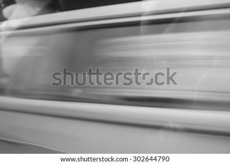 Motion blurred a part of car - stock photo