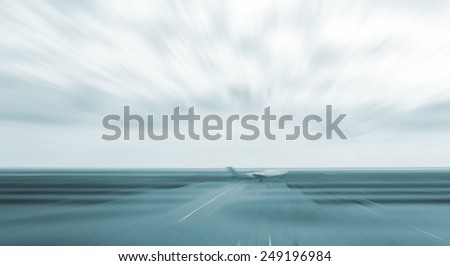 motion blurred airplane in runway                                - stock photo