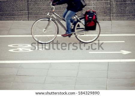 Motion blurred bicycle in profile - stock photo