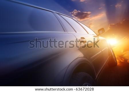 Motion blurred car on asphalt road - stock photo