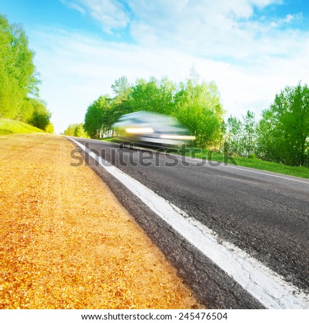 Motion blurred car on the road.  - stock photo