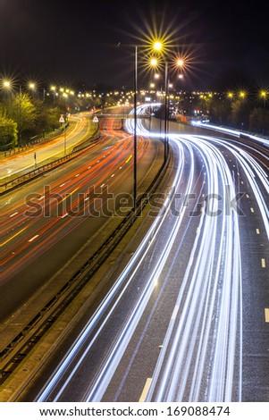 Motion blurred city road traffic  - stock photo