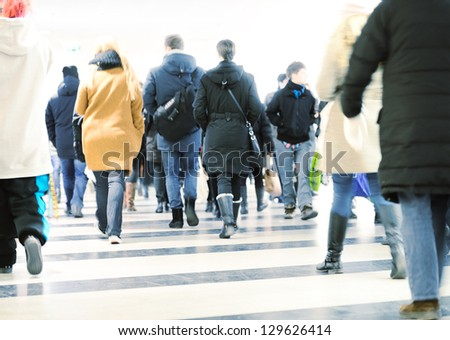 Motion blurred crowd against bright light - stock photo