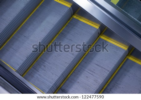 Motion blurred escalator in airport - stock photo