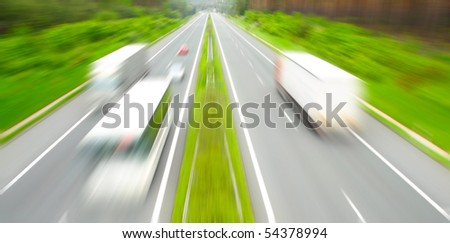 Motion blurred highway with traffic.