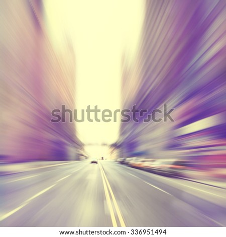 Motion blurred image of a city street scene.Vintage style. - stock photo