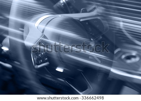motion blurred image of car steering wheel - stock photo