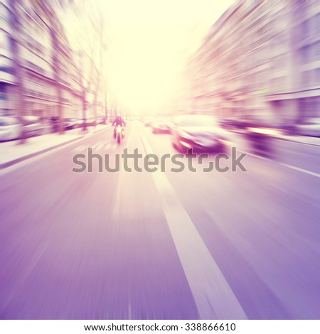Motion blurred image of city traffic. Vintage style. - stock photo