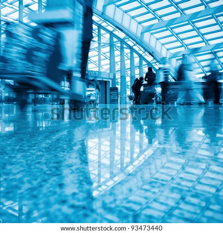 motion blurred passenger walking  in beijing capital airport - stock photo