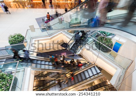 Motion Blurred People in Escalator of the Shopping Mall - stock photo
