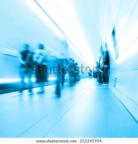 Motion blurred people in subway station.  - stock photo