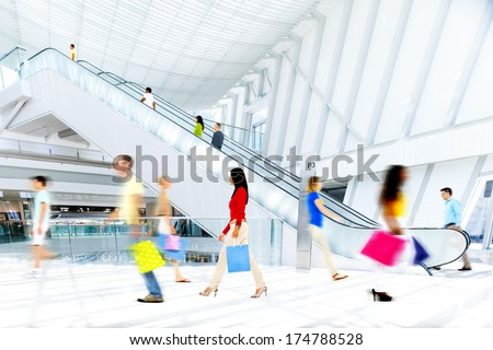 Motion Blurred People in the Shopping Mall - stock photo