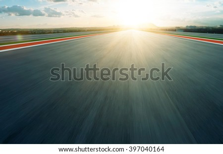 Motion blurred racetrack,evening - stock photo