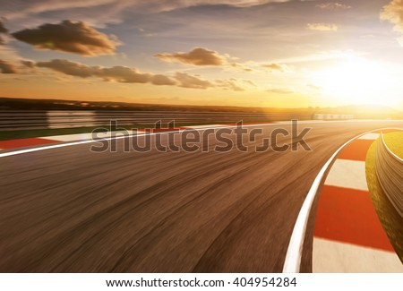 Motion blurred racetrack,golden hour mood - stock photo
