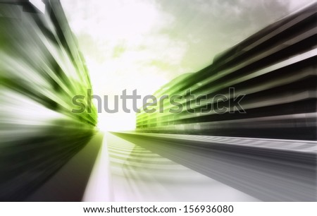 motion blurred racetrack in business city wallpaper illustration - stock photo