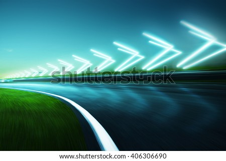 Motion blurred racetrack,night scene cold mood. with arrow light Effects.  - stock photo