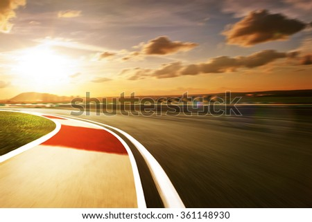 Motion blurred racetrack,sunset mood mood - stock photo