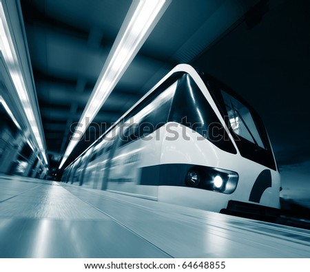 Motion blurred rapid train on station - stock photo
