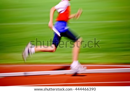 Motion blurred relay race.  Track and Field
