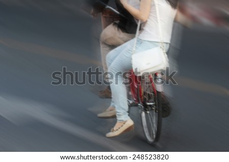 motion blurred ride bicycle on road - stock photo