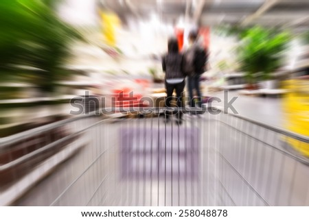 Motion blurred shopping inside home store - stock photo