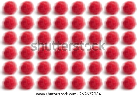 Motion blurred small raspberries abstract pattern on white background