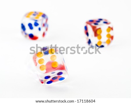 Motion blurred spinning dice against a background of two thrown dice - stock photo