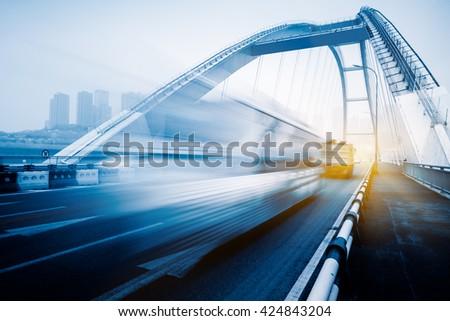 motion blurred traffic on bridge,chongqing china. - stock photo