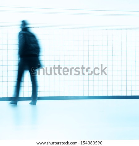 Motion blurred waiting man at subway station. - stock photo