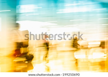 motion business traveler at airport, toned images. - stock photo
