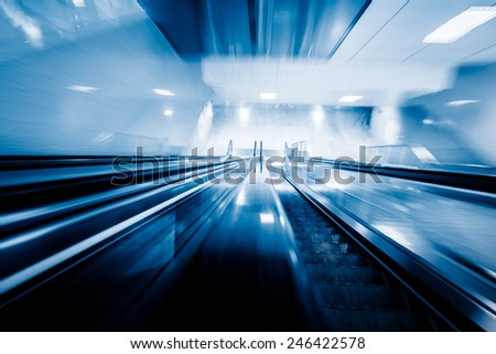 motion escalator at airport, concept of business background, blue toned images. - stock photo