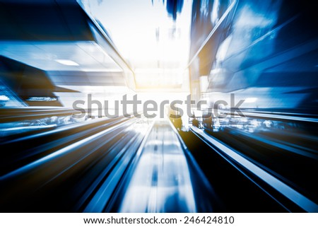 motion escalator at airport  concept of business background, blue toned images. - stock photo