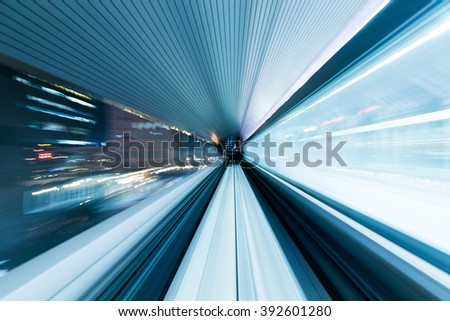 Motion of city in monorail - stock photo