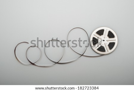 Motion picture film reel. - stock photo