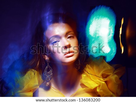 Motion. Stylized Woman in Radiant Abstract Lights. Illusion - stock photo